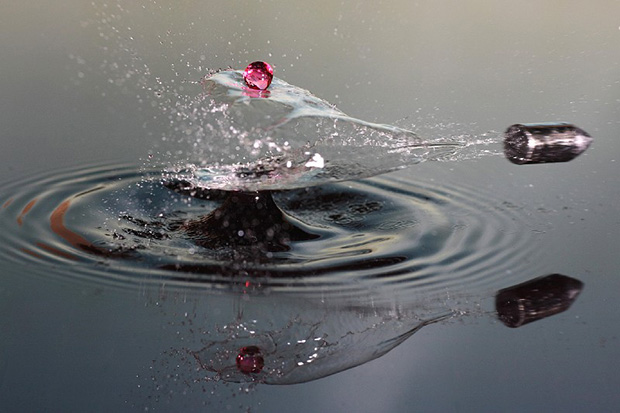 A bullet piercing through water