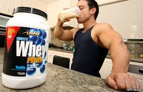 man drinking protein supplement