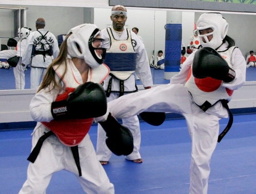 a couple martial arts students having a battle